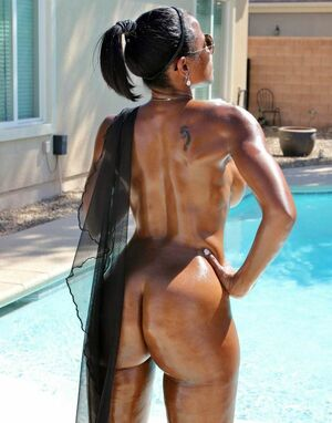Titted Black milf in the pool, she looks like a million dollars